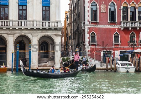 VENICE, ITALY - on MAY 3, 2015. The gondola with passengers floats on the Grand channel (Canal Grande).