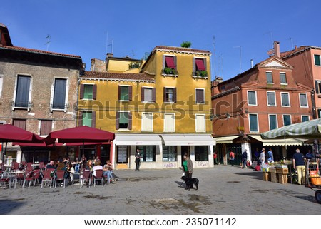 VENICE, ITALY - SEP 22, 2014: Campo Santa Margherita at sunrise. Tourists from all the world enjoy the historical city of Venezia in Italy, famous UNESCO World Heritage Site - stock photo