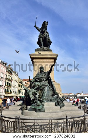 VENICE, ITALY - SEP 24, 2014: Equestrian monument Vittorio Emanuele II  on Riva Degli Schiavon, Venice. Tourists from all the world enjoy the historical city of Venezia in Italy,