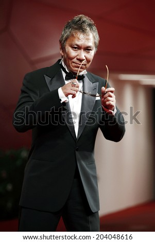 VENICE, ITALY - SEPTEMBER 09: Director Takashi Miike attends the '13 Assassins' premiere during the 67th Venice Film Festival on September 9, 2010 in Venice, Italy