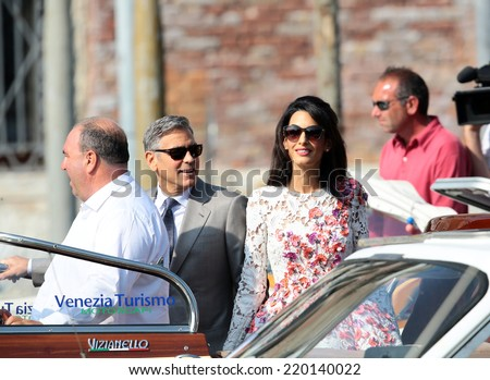 VENICE, ITALY - SEPTEMBER 28: George Clooney and Amal Alamuddin leaves the day after the gala dinner from Aman Hotel in Venice, Italy in September 28, 2014 in Venice, Italy  - stock photo