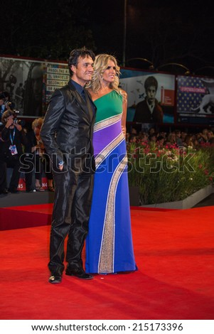 VENICE, ITALY - SEPTEMBER 04: Giulio Base and Tiziana Rocca attend 'Pasolini' Premiere during the 71st Venice Film Festival on September 4, 2014 in Venice, Italy.