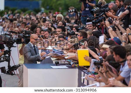 Venice, Italy - 03 September 2015: Stanley Tucci making autographs during the premiere of 'Looking For Grace' during the 72nd Venice Film Festival
