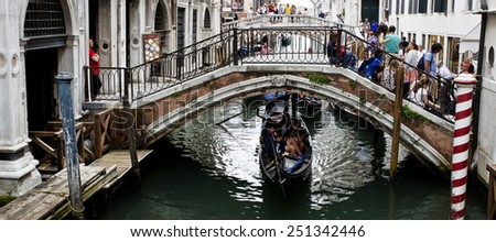 VENICE, ITALY SEPTEMBER 4, 2014: Tourists, bridges, canals and gondolas in Venice, Italy - stock photo