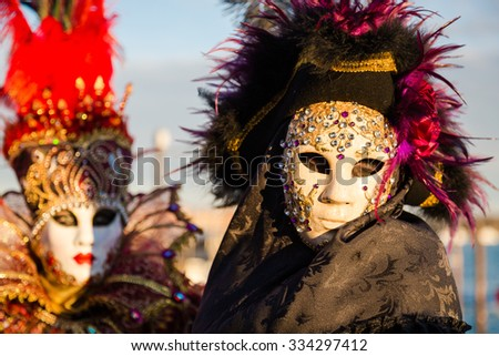 VENICE - January 14 : An unidentified person in a carnival costume attends the end Carnival of Venice , January 14, 2015 in Venice , Italy .