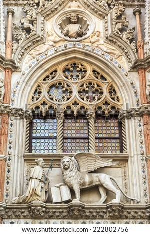 VENICE- JUN 2: Statues like this on St. Mark's cathedral undergoing renovation on the facade. The Church is an icon not just for Venice but the world., Italy on Jun 02 2014 - stock photo
