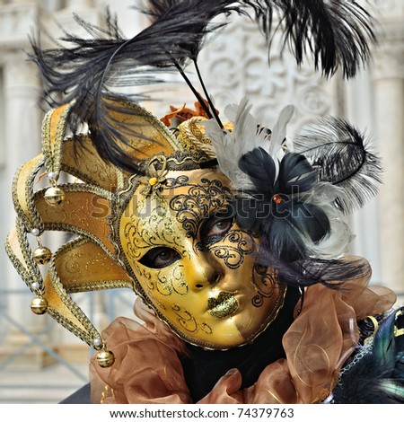 VENICE - MARCH 7: An unidentified masked person in costume in St. Mark's Square during the Carnival of Venice on March 7, 2011 in Venice. The 2011 carnival was held from February 26th to March 8th. - stock photo