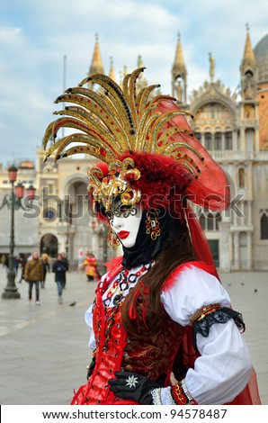 VENICE - MARCH 7: An unidentified masked person in costume in St. Mark's Square during the Carnival of Venice on March 7, 2011. The 2011 carnival was held from February 26th to March 8th - stock photo