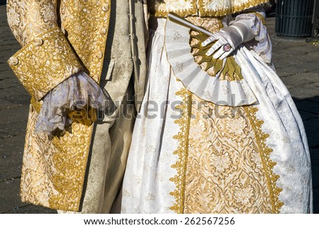 VENICE - March 15, 2015: People in Venetian costume attend the Carnival of Venice, festival starting two weeks before Ash Wednesday  in Venice, Italy. - stock photo
