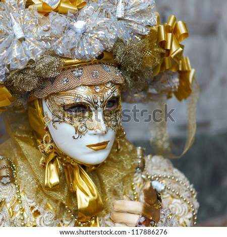 VENICE - MARCH 5: Person in Venetian costume attends the Carnival of Venice, festival starting two weeks before Ash Wednesday on March 5, 2011 in Venice, Italy. - stock photo