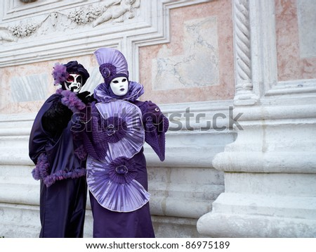 VENICE - MARCH 5: Unidentified people in Venetian costume attend the Carnival of Venice, annual festival starting two weeks before Ash Wednesday and ends on Shrove Tuesday, on March 5, 2011 in Venice, Italy.