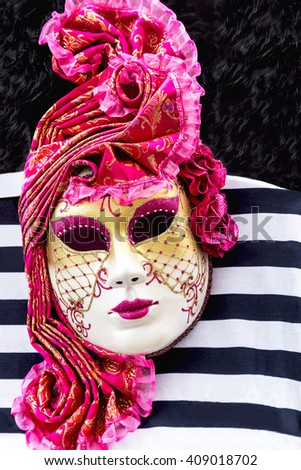 Venice mask. Italian carnival (festival) venetian mask is on the stripe marine background. Close up. Venice. Italy. Europe. Travel (vacation), art concept. - stock photo