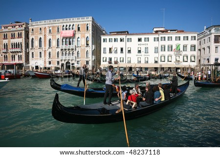 VENICE - OCTOBER 26: Crowded tourists on gondolas on October 26, 2009 in Venice, Italy. There were several thousand gondolas in the 18th century, with only several hundred today for tourism.