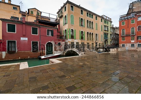 Venice picturesque houses and canal view with bridges in rainy winter day - stock photo