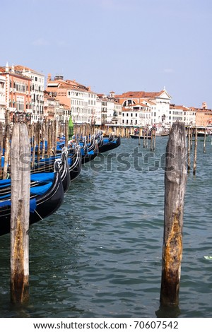 Venice's famous gondolas lined up in the lagoon - stock photo