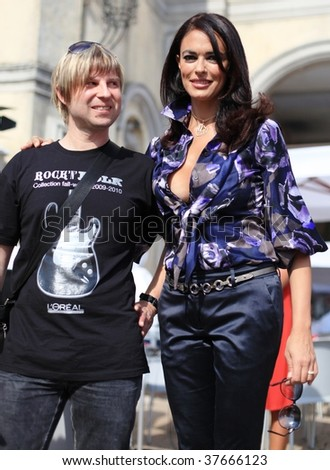VENICE - SEPTEMBER 16: Maria Grazia Cucinotta poses for a picture with an unidentified fan at the 66th International Venice Film Festival on September 16, 2009 in Venice, Italy.
