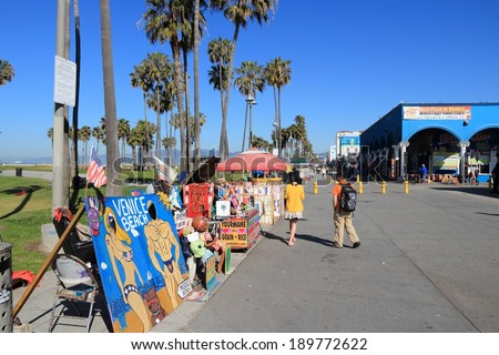 VENICE, UNITED STATES - APRIL 6, 2014: People visit Ocean Front Walk at Venice Beach, California. Venice Beach is one of most popular beaches of LA County. 9.8 million people live in LA County. - stock photo