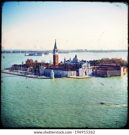 Venice with gondolas on Grand Canal against San Giorgio Maggiore church