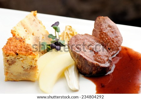 Venison meat steak with Quiche pie, Port Sauce,herbs and Potato  - stock photo
