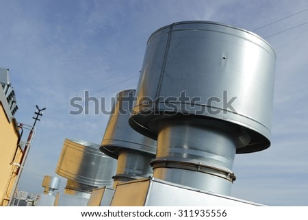 Vent pipes on the roof of an apartment house