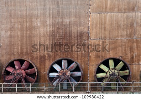 ventilation at old industrial steel factory, three ventilators in a row - stock photo