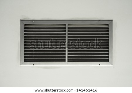 Ventilation on a wall of an industrial building - stock photo
