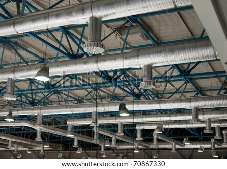 Ventilation system on the ceiling of large buildings - stock photo