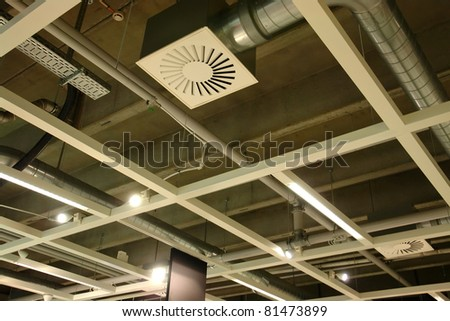 Ventilation system pipes on the ceiling of a modern factory plant building - stock photo