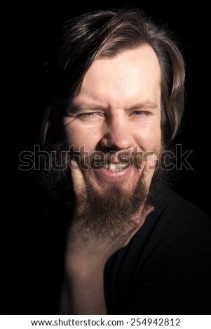 venturesome bearded man on a black background