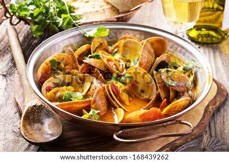 venus clams in tomato sauce - stock photo