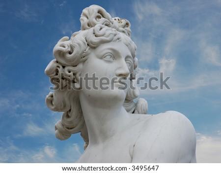 Venus statue against blue sky - stock photo