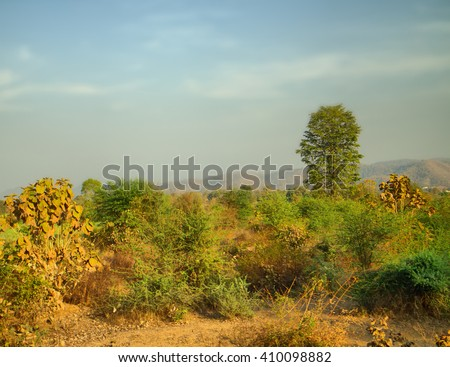 Verdant landscape. Green hills at entrance to plateau Deccan, India. Forest in late spring - stock photo