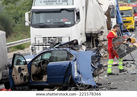 VERIA, GREECE - OCTOBER, 5, 2014:A large truck crashed into a number of cars and 4 people were killed and many were injured in a multi-vehicle collision that occurred on Egnatia Odos.  - stock photo