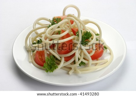 Vermicelli with tomatoes on a plate - stock photo