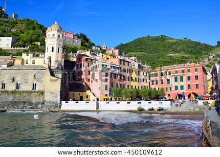 VERNAZZA, ITALY - JUNE 15 2016: Vernazza is a small village in the Cinque Terre and local people have built colorful houses on rocky, steep territory overlook the Liguria sea.