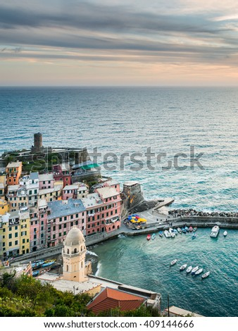 Vernazza village, Ocean Rugged Coast Harbour, Castello Doria Aerial View Panorama Scenic Postcard view under Dramatic Sky Blur Cloud at twilight in Summer. Cinque Terre National Park, Liguria, Italy