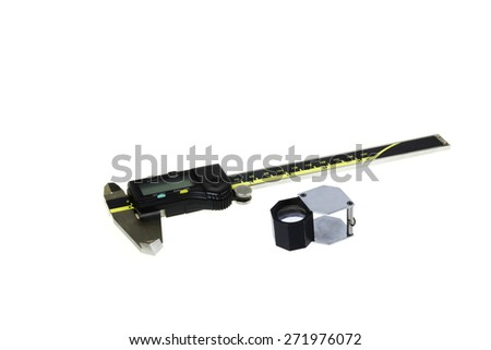Vernier calliper with Gem loupe on white background - stock photo
