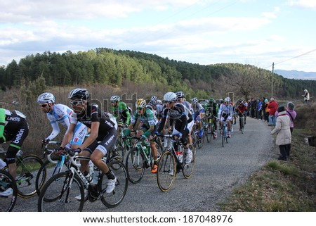 VERNON, FRANCE - MAR 01: Japanese Fumiyuki Beppu in peloton pack riding La Classic Sud Ardeche UCI Europe Tour Pro Race on March 01, 2014 in Versas Hill, Ardeche, France. Florian Vachon won the race. - stock photo