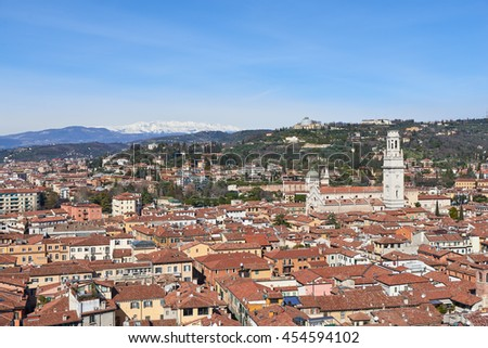 Verona Cathedral, Striped Romanesque cathedral opening to a lavish, frescoed interior & artwork by Titian. View from Torre dei Lamberti. - stock photo