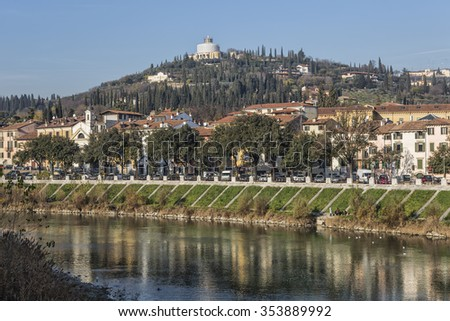 Verona, Italy - Adige River with Sanctuary of Nostra Signora di Lourdes - stock photo