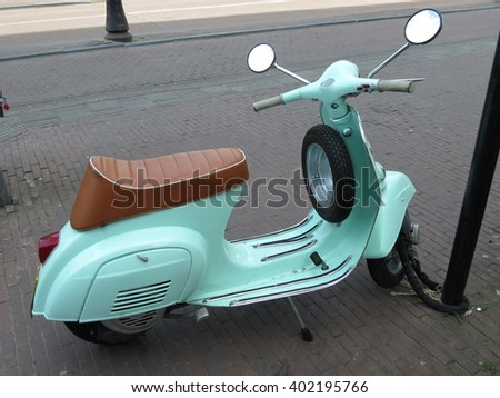 VERONA, ITALY - CIRCA APRIL 2013: Italian Vespa scooter dating back to the 1960s parked on the street - stock photo