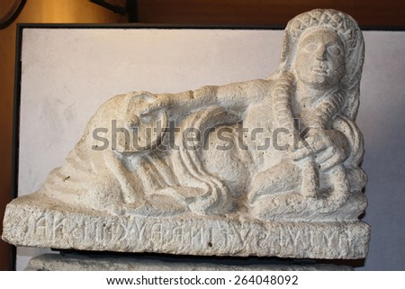 VERONA, ITALY - MARCH 18: An Etruscan cinerary urn top in Museo Lapidario Maffeiano at Piazza Bra on March 18, 2015 in Verona.The deceased with a patera and garland, in 2nd century B.C. From Perugia. - stock photo