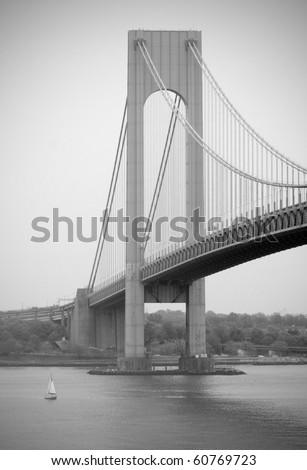 Verrazano Bridge next to small sailboat, black and white - stock photo