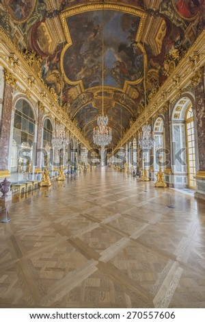 VERSAILLES, FRANCE - APRIL 18, 2015 : The hall of mirrors (Galerie des glasses) in the central wing of Palace of Versailles, the residence of the sun king Louis XIV.