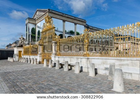 VERSAILLES, FRANCE - AUG 30: Golden gate of the Royal Chateau of Versailles on May 30, 2015 at the Palace of Versailles near Paris, France