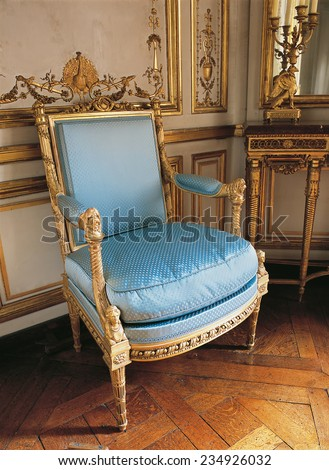 Versailles, France - 10 August 2014 : Old armchair at Versailles Palace ( Chateau de Versailles ). It was added to the UNESCO list of World Heritage Sites.  - stock photo