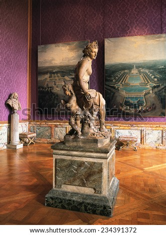 Versailles, France - 10 August 2014 : Pink room with painting and statues at Versailles Palace ( Chateau de Versailles ). It was added to the UNESCO list of World Heritage Sites.