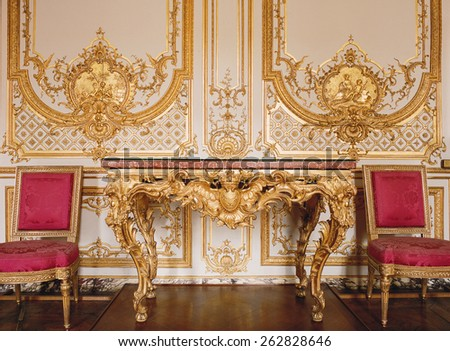 Versailles, France - 10 August 2014 : Wood wall with gold ornaments at Versailles Palace ( Chateau de Versailles ). It was added to the UNESCO list of World Heritage Sites. - stock photo