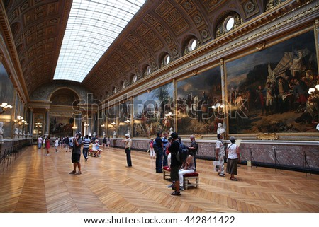 VERSAILLES, FRANCE - JULY 30, 2013: Hall at Versailles Palace (Chateau de Versailles), June 30, 2013, Paris, France. Every day many tourists wish to visit Versailles Palace. Added to the UNESCO.