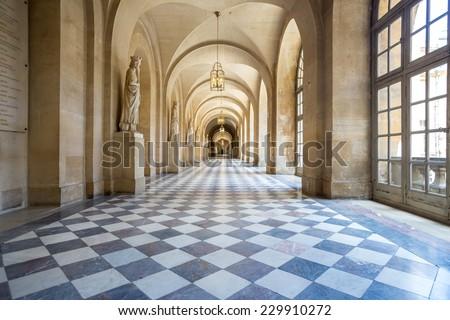 Versailles, France - JUN 20: Interior of main corridor at Chateau de Versailles (Palace of Versailles) on June 20, 2014, France. Versailles palace is in UNESCO World Heritage Site list since 1979. - stock photo
